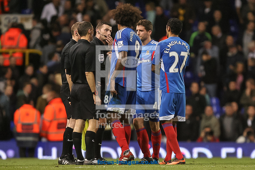 Picture by Daniel Chesterton/Focus Images Ltd +44 7966 018899<br /> 27/10/2013<br /> Tom Huddlestone of Hull City, Alex Bruce of Hull City and Ahmed Elmohamady of Hull City confront referee Michael Oliver and his assistants after the Barclays Premier League match at White Hart Lane, London.