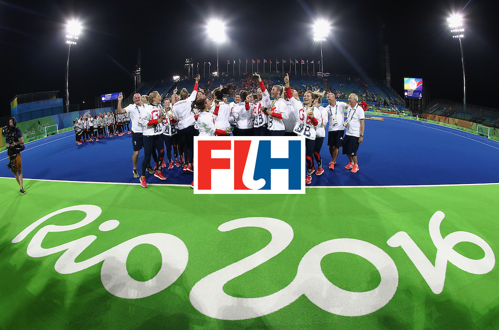 RIO DE JANEIRO, BRAZIL - AUGUST 19:  Team Great Britain celebrate after defeating Netherlands in the Women's Gold Medal Match on Day 14 of the Rio 2016 Olympic Games at the Olympic Hockey Centre on August 19, 2016 in Rio de Janeiro, Brazil.  (Photo by David Rogers/Getty Images)