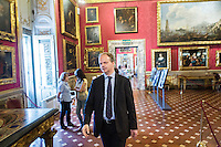 "FLORENCE, ITALY - 29 JUNE 2016: The new director of the Uffizi Gallery Eike Schmidt walks through Palazzo Pitti after introducing and explaining the photography exhibition ""Karl Lagerfeld – Visions of Fashion"" hosted by Palazzo Pitti in Florence, Italy, on June 29th 2016.<br /> <br /> Art historian Eike Schmidt, former curator and head of the Department of Sculpture, Applied Art and Textiles at the Minneapolis Institute of Arts, became the first non-Italian director of the Uffizi in August 2015, replacing Antonio Natali who directed the gallery for 9 years. One of the main goals of the new director is to open the Vasari Corridor to the general public. Currently the corridor can only be visited with group reservations made by external tour and travel agencies throughout the year.<br /> <br /> The Vasari Corridor is is a 1-kilometer-long (more than half mile) elevated enclosed passageway which connects the Palazzo Vecchio with the Palazzo Pitti, passing through the Uffizi Gallery and crossing the Ponte Vecchio above the Arno River, in Florence. The passageway was designed and built in 1564 by Giorgio Vasari in only 6 months to allow Cosimo de' Medici and other Florentine elite to walk safely through the city, from the seat of power in Palazzo Vecchio to their private residence, Palazzo Pitti. The passageway contains over 1000 paintings, dating from the 17th and 18th centuries, including the largest and very important collection of self-portraits by some of the most famous masters of painting from the 16th to the 20th century, including Filippo Lippi, Rembrandt, Velazquez, Delacroix and Ensor."