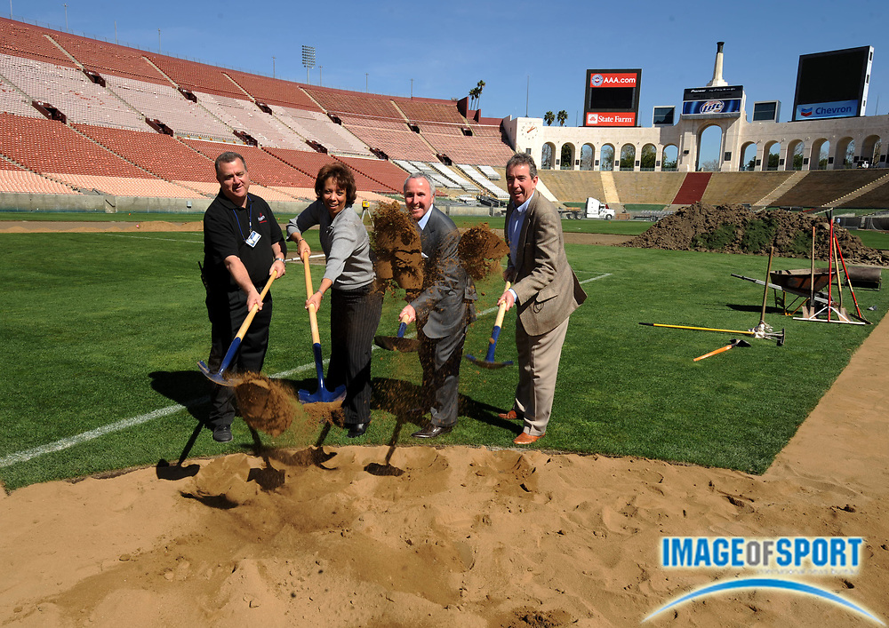 Feb 27, 2008; Los Angeles, CA, USA; (From left:) Los Angeles Dodgers vice president of stadium operations Lon Rosenberg, Think Cure president Janet Clayton, Los Angeles Dodgers owner Frank McCourt and Los Angeles Memorial Coliseum general manager Pat Lynch at press conference to announce groundbreaking for exhibition game between the Boston Red Sox and Los Angeles Dodgers at the Los Angeles Memorial Coliseum on Mar. 29, 2008.