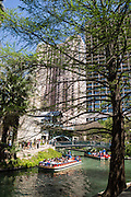 The San Antonio River Walk (Paseo del Río) is a network of pedestrian walkways along the banks of the San Antonio River, one story beneath the streets of Downtown San Antonio, Texas, USA. The River Walk connects from the Alamo to Rivercenter Mall.