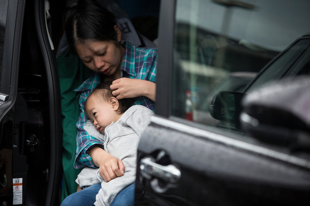 KUMAMOTO, JAPAN - APRIL 21: A family, survived from earthquake is seen in the car early morning on April 21, 2016 in Mashiki Gymnasium parking area, Kumamoto, Japan. Over thousands of evacuees sleep in the car and survivors are facing health threat, health experts says, 20 people diagnosed in Mashiki, one has died and 2 are in critical condition.<br /> As of April 45 people were confirmed dead after strong earthquakes rocked Kyushu Island of Japan. Nearly 11,000 people are reportedly evacuated after the tremors Thursday night at magnitude 6.5 and early Saturday morning at 7.3.<br /> <br /> Photo: Richard Atrero de Guzman