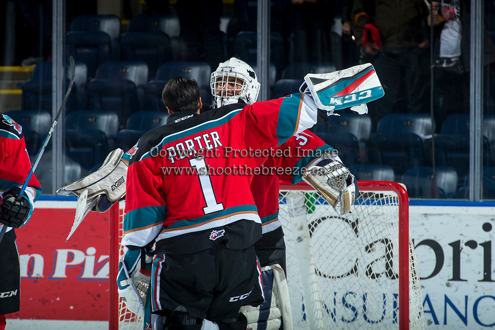 KELOWNA, CANADA - NOVEMBER 25: James Porter #1 congratulates Roman Basran #30 of the Kelowna Rockets on the shut out win against the Medicine Hat Tigers on November 25, 2017 at Prospera Place in Kelowna, British Columbia, Canada.  (Photo by Marissa Baecker/Shoot the Breeze)  *** Local Caption ***