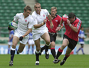 24/05/2002 (Friday).Sport -Rugby Union - London Sevens.England vs Canada.Nick Duncombe, supported by Tony Roques.[Mandatory Credit, Peter Spurier/ Intersport Images].