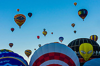Hot air balloons lifting off, Balloon Fiesta Park, Albuquerque International Balloon Fiesta, Albuquerque, New Mexico USA.