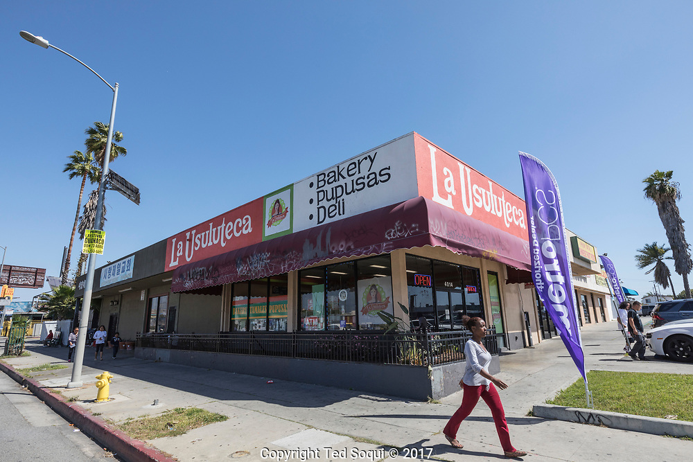 25 years later, the former Trak Auto Parts store is now a restaurant named La Usuluteca. The area has seen spotty redevelopment after the LA92 riots.<br /> <br /> 25 before and after LA92 photo project.