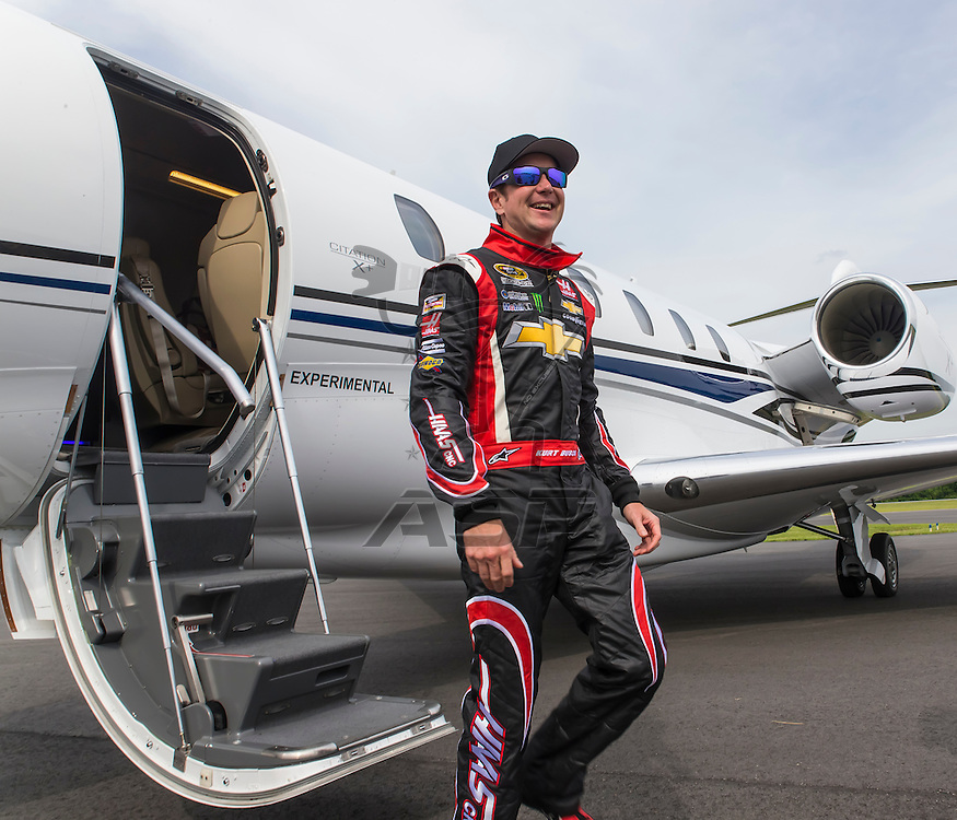 Indianapolis, IN - May 25, 2014:  NASCAR driver, Kurt Busch (26), boards his Cessna Citation X for his trip to Concord, NC to run the Coca-Cola 600 at Charlotte Motor Speedway.  <br /> <br /> MANDATORY PHOTO CREDIT:  Walter G. Arce, Sr. KBI/ActionSportsInc.com