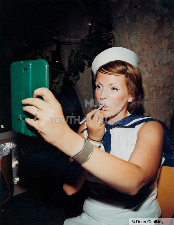 A Girl in a sailor outfit applying her make up Ibiza 2001