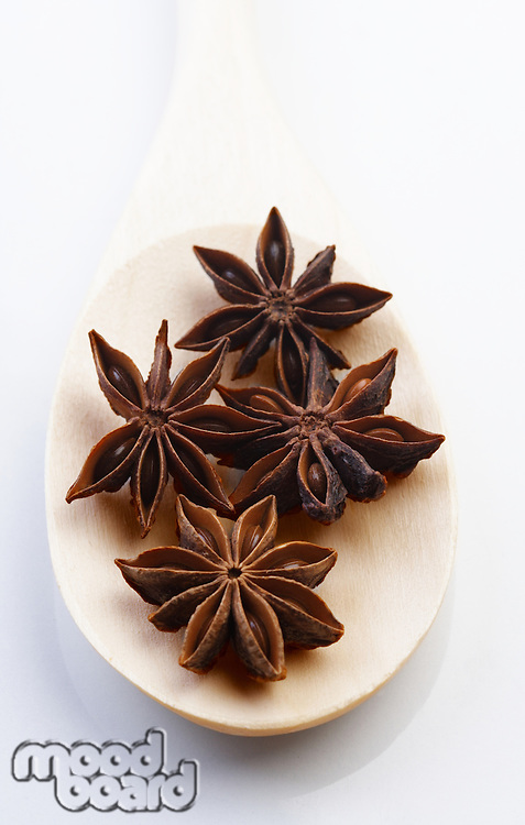 Close up of anise on wooden spoon