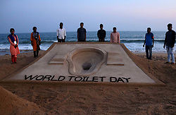 November 18, 2018 - Bhubaneswar, Odisha, India - A sand sculpture is seen at the Bay of Bengal Sea's eastern coast beach at Puri, as it is creating by International sand artist Sudarshan Pattnaik on the occasion of World Toilet Day, 65 km away from the eastern Indian state Odisha's capital city Bhubaneswar, on 18 November 2018. (Credit Image: © Str/NurPhoto via ZUMA Press)