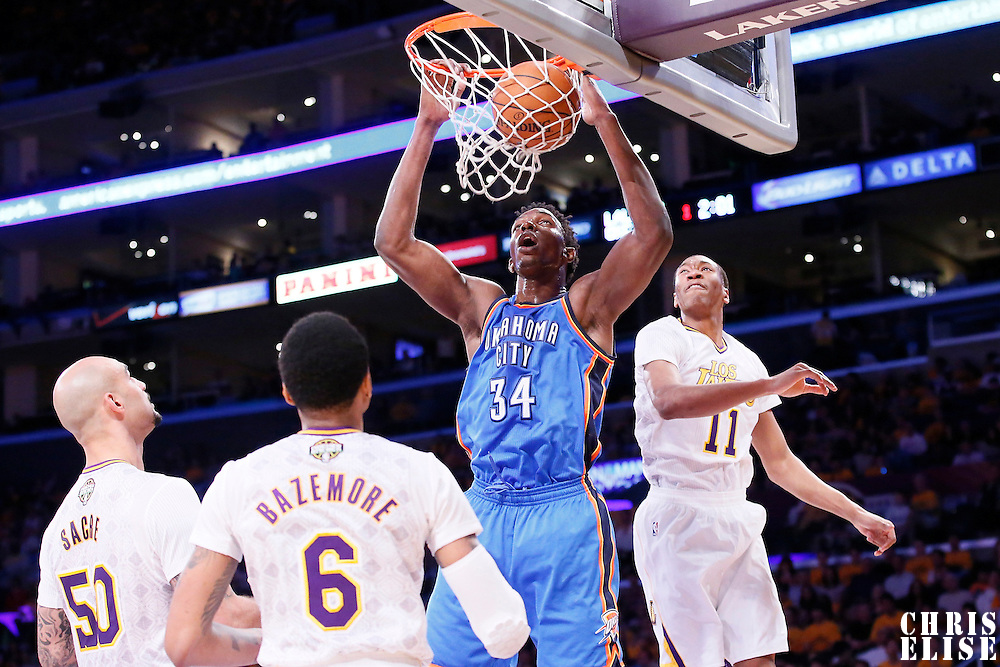 09 March 2014: Oklahoma City Thunder center Hasheem Thabeet (34) dunks the ball past Los Angeles Lakers small forward Wesley Johnson (11) during the Los Angeles Lakers 114-110 victory over the Oklahoma City Thunder at the Staples Center, Los Angeles, California, USA.