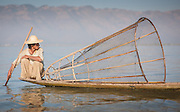 Fisherman on his boat in Inle Lake (Myanmar)