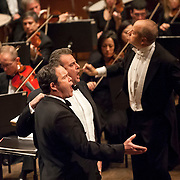 """November 11, 2012 - New York, NY : Accompanied by members of the Metropolitan Opera Orchestra and The New York Choral Society, and conducted by Patrick Summers (standing, right) , baritone Gerald Finley (foreground, left) and tenor Marcello Giordani (center) perform Giuseppe Verdi's """"Si pel ciel"""" from Otello during the 2012 Richard Tucker Gala and concert in Lincoln Center's Avery Fisher Hall on Sunday evening. CREDIT: Karsten Moran for The New York Times"""