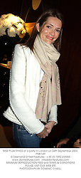 MISS PLUM SYKES at a party in London on 24th September 2003.PNB 149