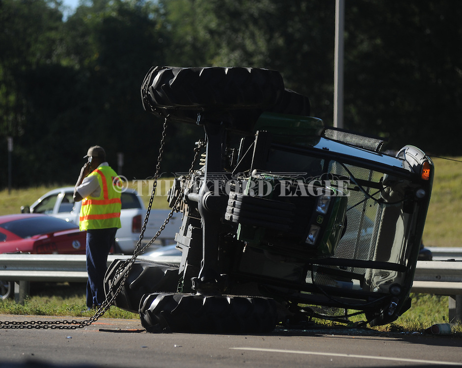 According to police, an MDOT contracted tractor cutting grass on Highway 6 near South Lamar was struck by  a Jeep Liberty, overturning both vehicles, at 4:47 p.m. in Oxford, Miss. on Tuesday, September 6, 2011. No serious injuries were reported.