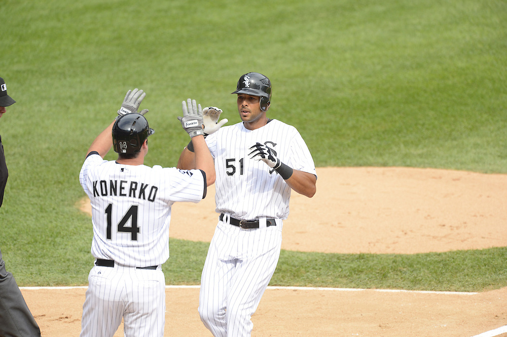 CHICAGO - SEPTEMBER 05:  Alex Rios #51 celebrates with Paul Konerko #14 of the Chicago White Sox after Rios hit a two-run home run  against the Minnesota Twins on September 05, 2012 at U.S. Cellular Field in Chicago, Illinois.  The White Sox defeated the Twins 6-2.  (Photo by Ron Vesely)  Subject:    Alex Rios; Paul Konerko