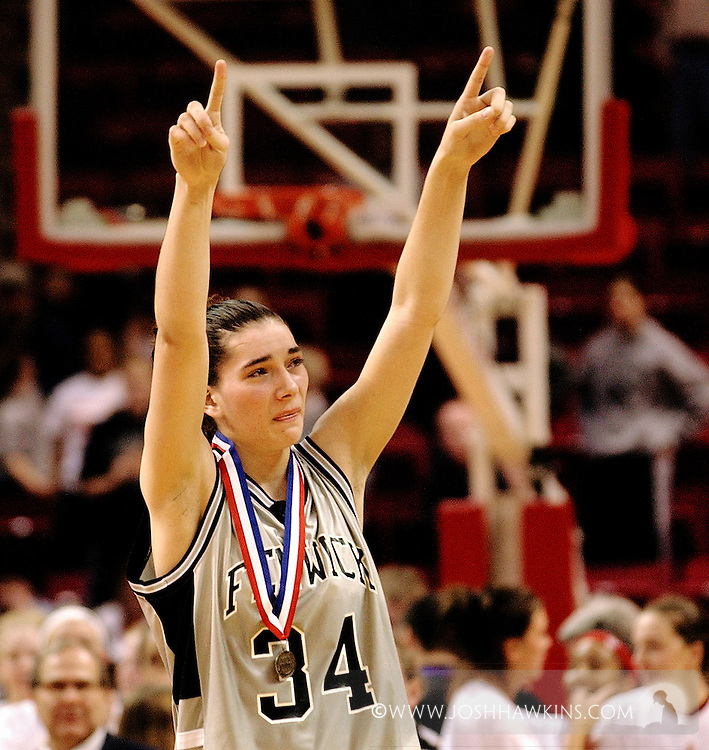 Erin Lawless with 2nd place medal after losing the Illinois Class-AA Girls Basketball Championship Game in Bloomington-Normal, IL..