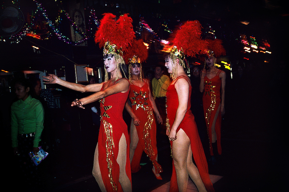 Transvestite performers about to go on stage in a downtown bar. The repertoire of these 'comrades' included old Communist songs. The bar closed several months later. ..From China [sur]real © Mark Henley...