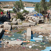 Brackish water full of rubbish in Kara Tepe camp.