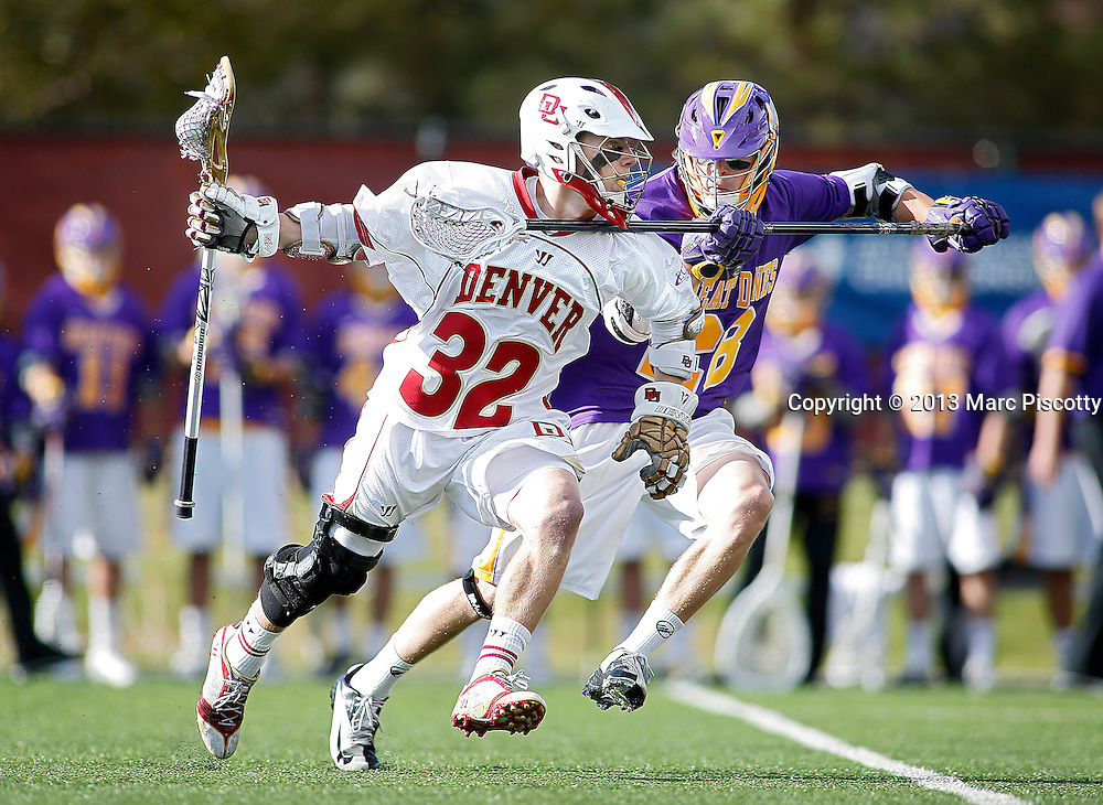 SHOT 5/11/13 5:37:28 PM - Denver's Chase Carraro #32 tries to fend off Albany's Eric Cantor #28 during their first round NCAA Tournament lacrosse game at the Peter Barton Lacrosse Stadium on the University of Denver campus Saturday May 11, 2013. The University of Denver won the game 19-14 to advance. (Photo by Marc Piscotty / © 2013)