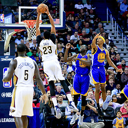 Oct 28, 2016; New Orleans, LA, USA;  New Orleans Pelicans forward Anthony Davis (23) dunks past Golden State Warriors guard Patrick McCaw (0) and forward Draymond Green (23) during the second quarter of a game at the Smoothie King Center. Mandatory Credit: Derick E. Hingle-USA TODAY Sports