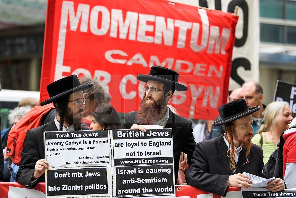 © Licensed to London News Pictures. 04/09/2018. London, UK. Anti-zionist and Pro Jeremy Corbyn members of the Jewish Community protest outside the Labour Party headquarters in London ahead of a National Executive Committee meeting. The Labour Party's ruling body is expected to vote on whether to adopt, in full, the IHRA (International Holocaust Remembrance Alliance) definition of anti-Semitism. Photo credit: Ben Cawthra/LNP