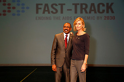 Nov. 18, 2014 - Los Angeles, California, USA - Executive Director of UNAIDS Michel Sidibe (L) and actress Charlize Theron attend the launch of UNAIDS New Fast Track Report ahead of World AIDS Day 2014 at UCLA on November 18, 2014 in Los Angeles (Credit Image: © Future-Image/ZUMA Wire)