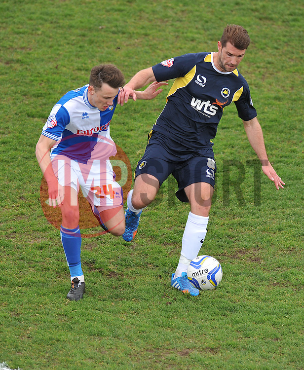 Bristol Rovers' Ollie Clarke battles for the ball with Torquay United's Ben Harding  - Photo mandatory by-line: Alex James/JMP - Mobile: 07966 386802 12/04/2014 - SPORT - FOOTBALL - Bristol - Memorial Stadium - Bristol Rovers v Torquay United - Sky Bet League Two