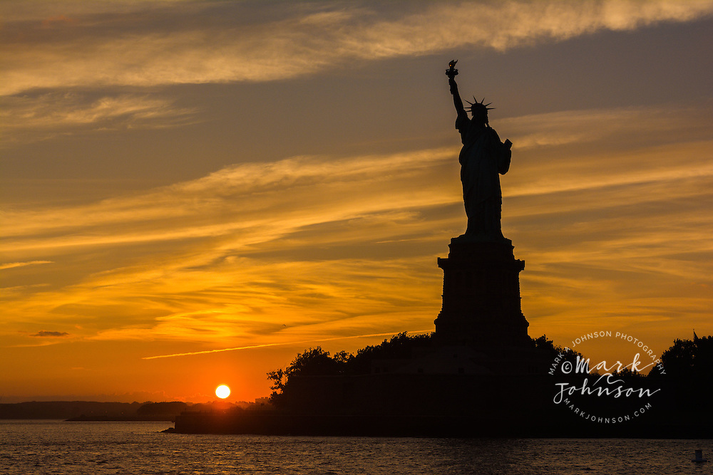Silhouette of the Statue of Liberty at sunset, Liberty Island, New York Harbor, New York City, New York, USA