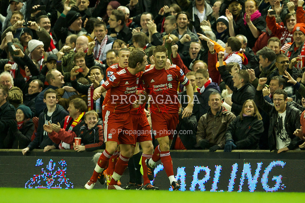 LIVERPOOL, ENGLAND - Wednesday, January 25, 2012: Liverpool's captain Steven Gerrard celebrates scoring the first goal against Manchester City during the Football League Cup Semi-Final 2nd Leg at Anfield. (Pic by David Rawcliffe/Propaganda)