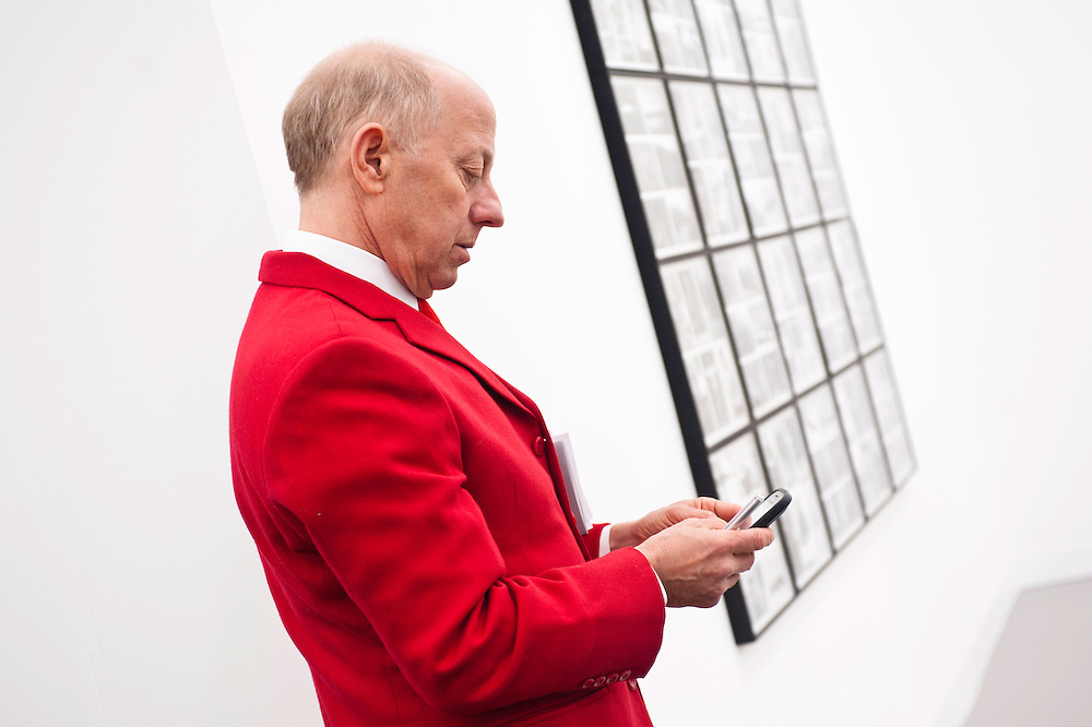 London, UK - 11 October 2012: a man in a red suit during the Frieze Art Fair 2012, London's big annual art fair that takes place in Regent's Park. It sells the works by more than 1,000 of the world's leading artists, represented by some 170 international galleries.