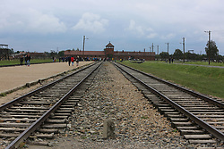 Rail track leading to the main entrance to Auschwitz II (Birkenau) Nazi concentration camp, in Auschwitz, Poland on September 3, 2017. Auschwitz concentration camp was a network of German Nazi concentration camps and extermination camps built and operated by the Third Reich in Polish areas annexed by Nazi Germany during WWII. It consisted of Auschwitz I (the original camp), Auschwitz II–Birkenau (a combination concentration/extermination camp), Auschwitz II–Monowitz (a labor camp to staff an IG Farben factory), and 45 satellite camps. In September 1941, Auschwitz II–Birkenau went on to become a major site of the Nazi Final Solution to the Jewish Question. From early 1942 until late 1944, transport trains delivered Jews to the camp's gas chambers from all over German-occupied Europe, where they were killed en masse with the pesticide Zyklon B. An estimated 1.3 million people were sent to the camp, of whom at least 1.1 million died. Around 90 percent of those killed were Jewish; approximately 1 in 6 Jews killed in the Holocaust died at the camp. Others deported to Auschwitz included 150,000 Poles, 23,000 Romani and Sinti, 15,000 Soviet prisoners of war, 400 Jehovah's Witnesses, and tens of thousands of others of diverse nationalities, including an unknown number of homosexuals. Many of those not killed in the gas chambers died of starvation, forced labor, infectious diseases, individual executions, and medical experiments. In 1947, Poland founded a museum on the site of Auschwitz I and II, and in 1979, it was named a UNESCO World Heritage Site. Photo by Somer/ABACAPRESS.COM