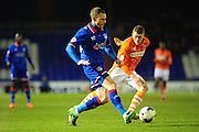 Brian Wilson of Oldham Athletic clears during the Sky Bet League 1 match between Oldham Athletic and Blackpool at SportsDirect.Com Park, Oldham, England on 15 March 2016. Photo by Mike Sheridan.