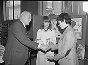 1980-03-07.7th March 1980.07/03/1980.03-07-80..Photographed at Maguire & Paterson, Dublin..Michael, a Match for any man:..Alan Buttanshaw, Managing Director of Maguire & Paterson shakes the hand of Michael Power (13),  winner of a £15 prize, Dunmein, Gusserane, New Rosss, Co Wexford while Ruth Buchanan, presenter of RTE's Poparama looks on .