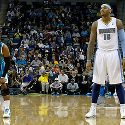 October 29, 2010; New Orleans, LA, USA; Denver Nuggets small forward Carmelo Anthony (15) and New Orleans Hornets point guard Chris Paul (3) on the court during the third quarter at the New Orleans Arena.  Mandatory Credit: Derick E. Hingle