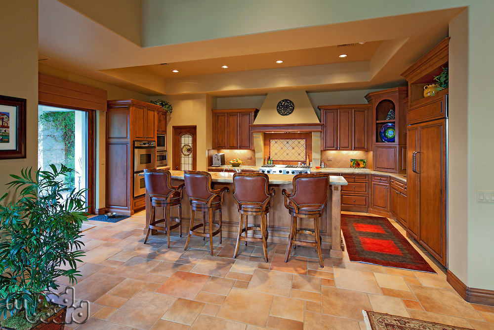 Chairs near contemporary kitchen counter in luxury manor house