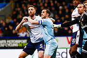 Bolton Wanderers defender Mark Beevers (5) battles with Sunderland defender John O'Shea (16)  during the EFL Sky Bet Championship match between Bolton Wanderers and Sunderland at the Macron Stadium, Bolton, England on 20 February 2018. Picture by Simon Davies.