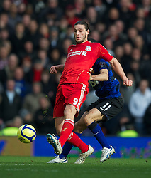 LIVERPOOL, ENGLAND - Saturday, January 28, 2012: Liverpool's Andy Carroll in action against Manchester United during the FA Cup 4th Round match at Anfield. (Pic by David Rawcliffe/Propaganda)