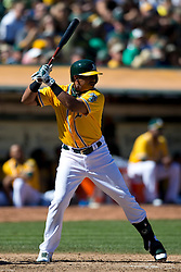OAKLAND, CA - SEPTEMBER 22: Yoenis Cespedes #52 of the Oakland Athletics at bat against the Minnesota Twins during the fifth inning at O.co Coliseum on September 22, 2013 in Oakland, California. The Oakland Athletics defeated the Minnesota Twins 11-7 as they clinched the American League West Division. (Photo by Jason O. Watson/Getty Images) *** Local Caption *** Yoenis Cespedes