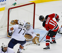 Nov 9, 2008; Newark, NJ, USA; Edmonton Oilers goalie Jeff Drouin-Deslauriers (38) makes a save on New Jersey Devils center John Madden (11) during the third period at the Prudential Center. The Oilers defeated the Devils 2-1.
