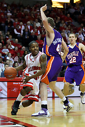 "12 January 2008: Keith ""Boo"" Richardson charges from right to left along the baseline and gets fouled by Pieter Van Tongeren during a game in which  the Purple Aces of the University of Evansville lost to  the Redbirds of Illinois State on Doug Collins Court at Redbird Arena in Normal Illinois by a score of 74-66."