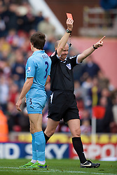 STOKE, ENGLAND - Sunday, October 19, 2008: Tottenham Hotspur's Gareth Bale is shown the red card by referee Lee Mason during the Premiership match against Stoke City at the Britannia Stadium. (Photo by David Rawcliffe/Propaganda)