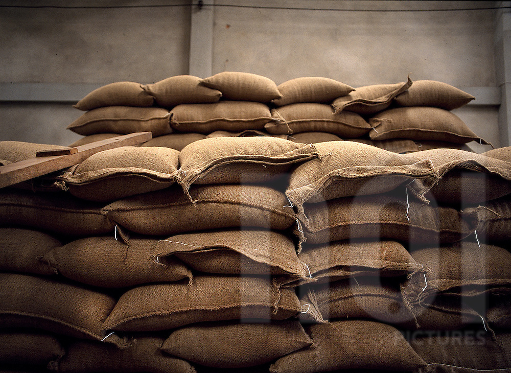 Storage of hessian bags containing coffee beans waiting to be delivered. Paksong, Laos, Asia