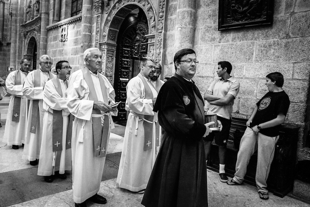 Procession of priests about to say mass in the cathedral of Santiago de Compostela, Spain