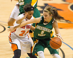 Greenbrier East forward Katelyn Wilmer (5) tries to get past South Charleston guard Shy'Anne Dunham (24) during a first round game at the Charleston Civic Center.