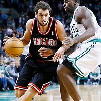 18 January 2013: Chicago Bulls shooting guard Marco Belinelli (8) drives past Boston Celtics power forward Brandon Bass (30) during the Chicago Bulls 100-99 overtime victory over the Boston Celtics at the TD Garden, Boston, Massachusetts, USA.