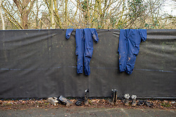 "© Licensed to London News Pictures. 11/12/2019. Gerrards Cross, UK. Search team overalls hang on crime scene barriers with boots sitting below as the Metropolitan Police Service continues to search woodland in Gerrards Cross, Buckinghamshire. Police have been in the area conducting operations since Thursday 5th December 2019. In a press statement issued on 7th December, a Metropolitan Police spokesperson said ""Officers are currently in the Gerrards Cross area of Buckinghamshire as part of an ongoing investigation.<br /> ""We are not prepared to discuss further for operational reasons."" Photo credit: Peter Manning/LNP"