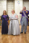 Anaheim , California - April 11, 2015: Her Territorial Highness Lady Edith Ortiz, Military Medical Officer of The House of Homestead, left, Queen Anastasia Sophia Maria Helena von Rubenroth Elphberg of Ruritania, middle, and King George II from Slabovia watch micronational dignitaries award medals to MicroCon 2015 Cotillion attendees at the Unitarian Universalist Church in Anaheim, CA Saturday April 11, 2015. <br /> <br /> CREDIT: Matt Roth