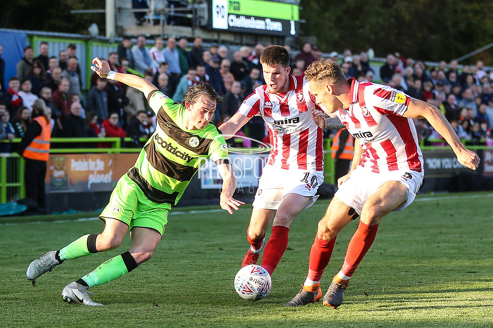 Forest Green Rovers Theo Archibald(18) takes on two Cheltenham Town defenders during the EFL Sky Bet League 2 match between Forest Green Rovers and Cheltenham Town at the New Lawn, Forest Green, United Kingdom on 20 October 2018.