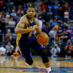 Feb 6, 2013; New Orleans, LA, USA; New Orleans Hornets shooting guard Eric Gordon (10) against the Phoenix Suns during  the first quarter of a game at the New Orleans Arena. Mandatory Credit: Derick E. Hingle-USA TODAY Sports